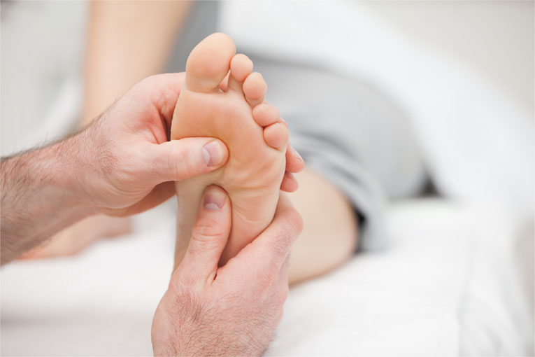 Examining a patient's foot.